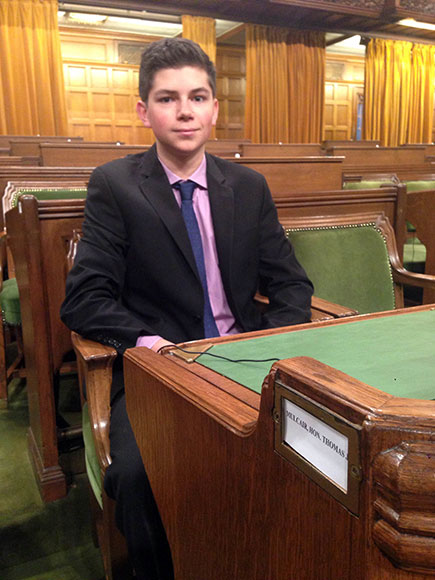 Hickson sits at Opposition Leader Thomas Mulcair's desk in the House of Commons.