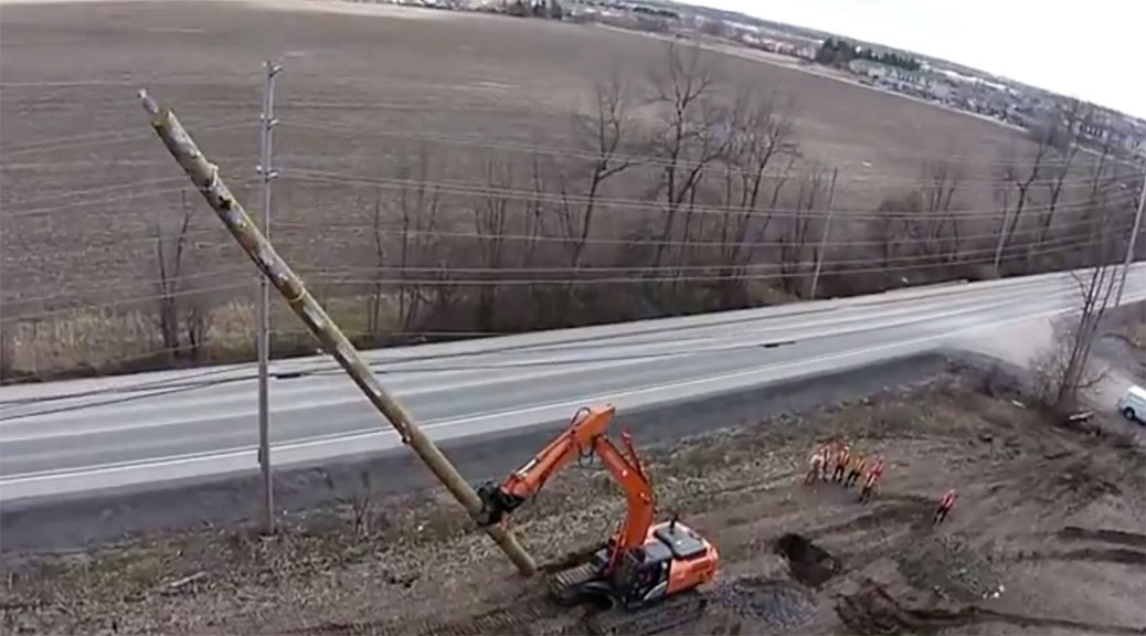 Still from Hien Hoang's video showing how hydro poles are erected along Huntmar