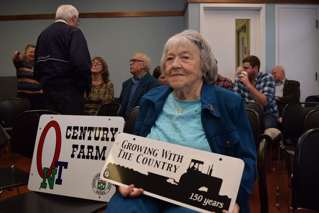 """We keep things going one way or another,"" said Lillian Hobbs, 91, the owner of the Hobbs farm. When she was called up to receive her sign, she cracked: ""I'm the oldest!"" and sent the audience into a chuckle. Photo by Devyn Barrie."