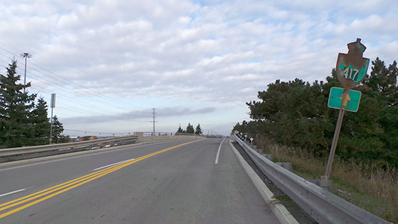 Pedestrians have a narrow shoulder to walk in on the east side of the bridge.