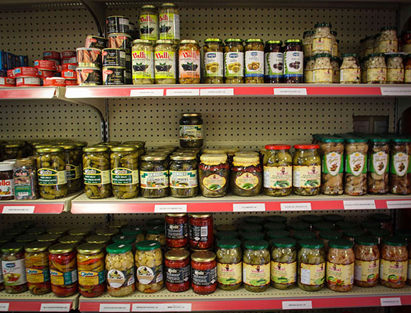 Shelves of jars - pickles and more.