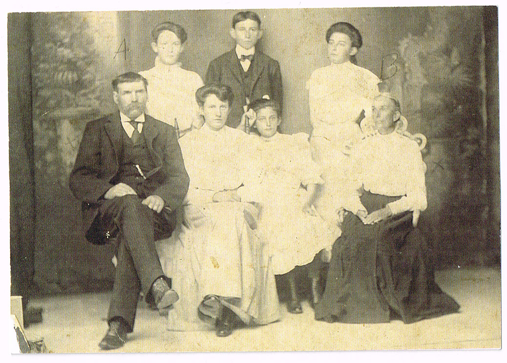 The James family. Front row, left to right: Thomas, Eliza Ann, Stella, Mary Ann.  Back row, left to right: Olive, Scott, Irene. Date unknown.