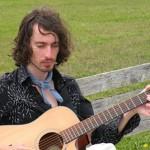 Folk musician Jared Lewis at Gaia Java on Friday