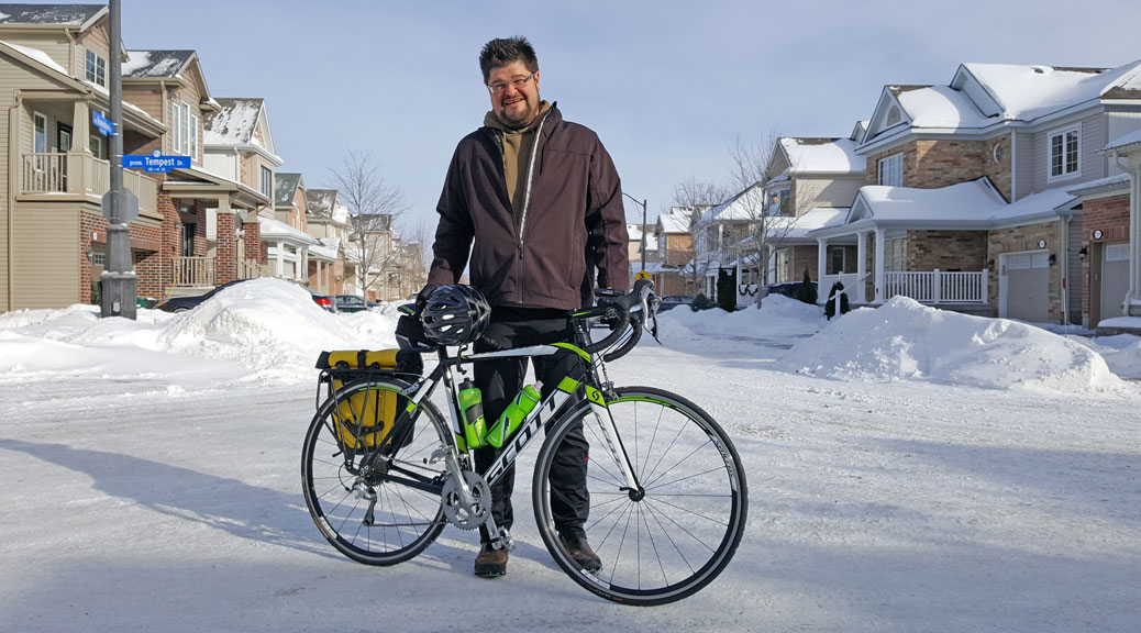 Jeff Tindall commutes by bike during spring, summer and fall, but not winter. During the colder months he rides inside. We staged this shot near his house on one of the coldest days of the year. Photo by Glen Gower.