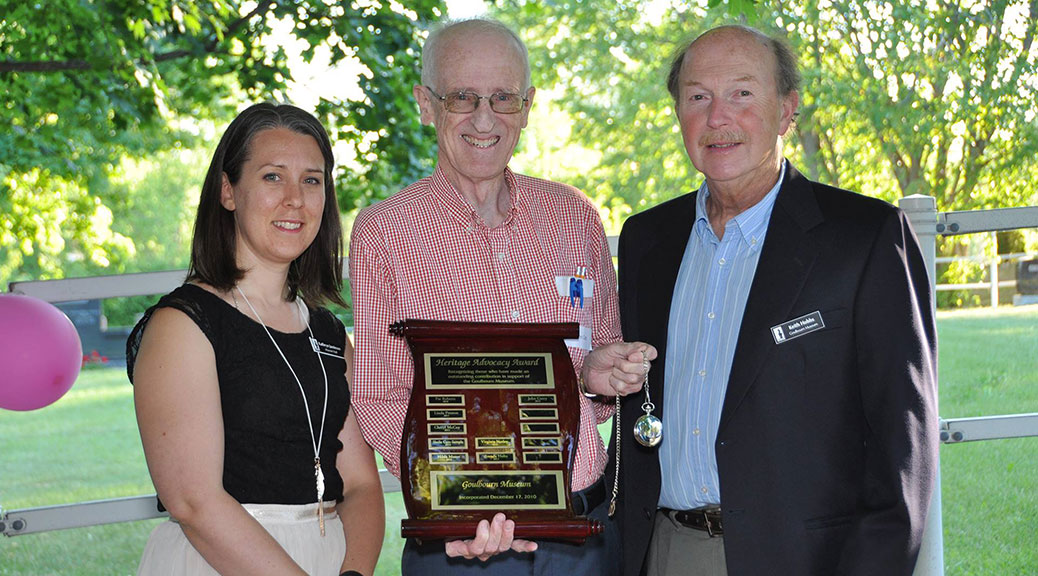 John Curry has been instrumental in the Goulbourn Museum's success and Kathryn Jamieson, Curator Manager, and the Museum's Chairperson, Keith Hobbs, presented him with the award at last night's Evening of Appreciation. (Photo via the Goulbourn Museum)