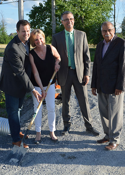 Sod-turning ceremony at Kanata Academy, June 1, 2016. from left to right: Dr. Kevin Rattray, Mrs. Shannon Rattray, Peter Gregor, Director of Development at Nautical Lands Group, Councillor Shad Qadri.