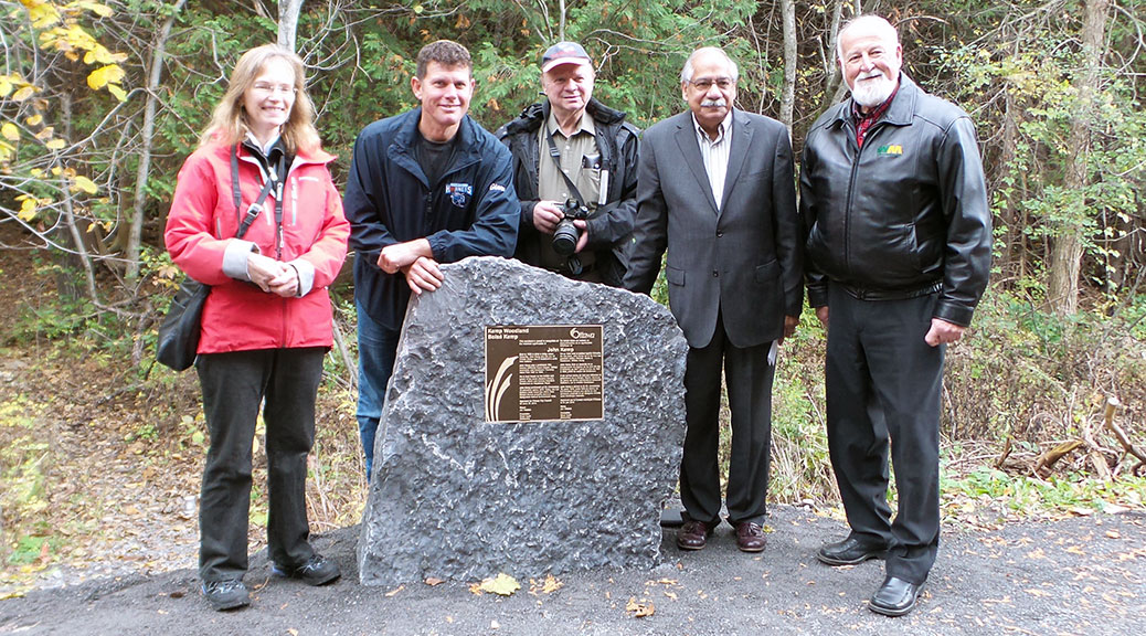 Unveiling of the Kemp Woodland plaque. Left to right: Janet Mason (Ottawa Stewardship Council), Glen Carr (Sacred Heart High School), Phil Sweetnam (Stittsville Village Association), Councillor Shad Qadri, Wayne French (Waste Management).
