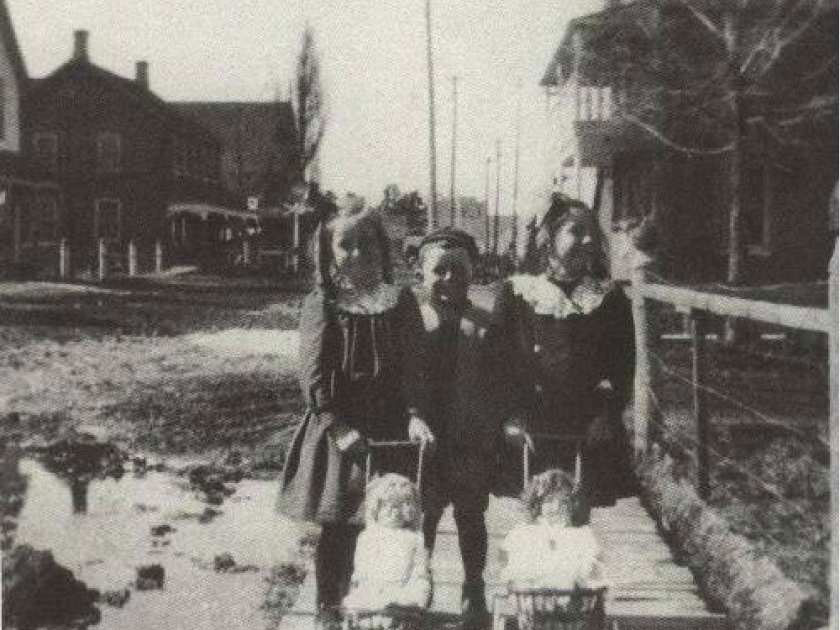 Kids on Main Street, 1915. The balcony of the Temperance Hotel can be seen in the background on the right side of the photo. Photo from the Goubourn Historical Society Collection.