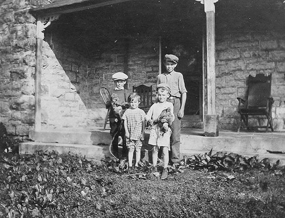Back left to right, Unknown, Vincent, son of Byron and Gertrude     Front left to right, Maybelle  and Lyman Boyd, children of Byron and Gertrude (around 1930). Photo courtesy of Melodie McCullogh.