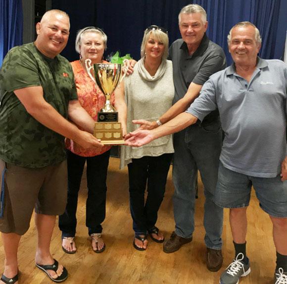 Mike Enid presenting trophy to Diane Doran, Sue Doran, Rick Doran and Brian Doran  - Tournament winners with 9 under par. Stittsville Legion Golf Tournament / August 2017.