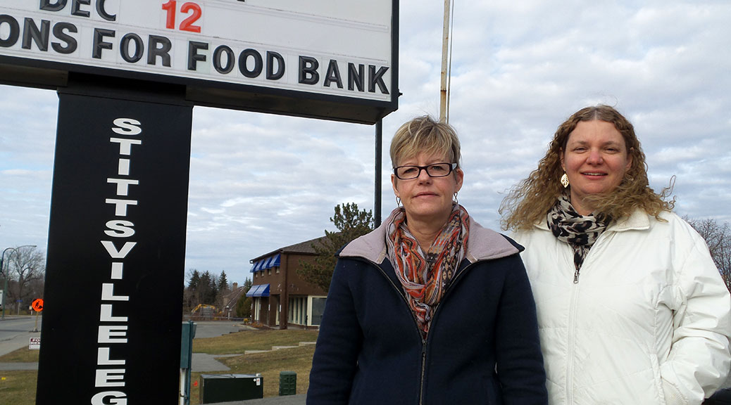 Legion executive members Sue McCormick (left) and Monique Vail in front of the Stittsville Legion sign.