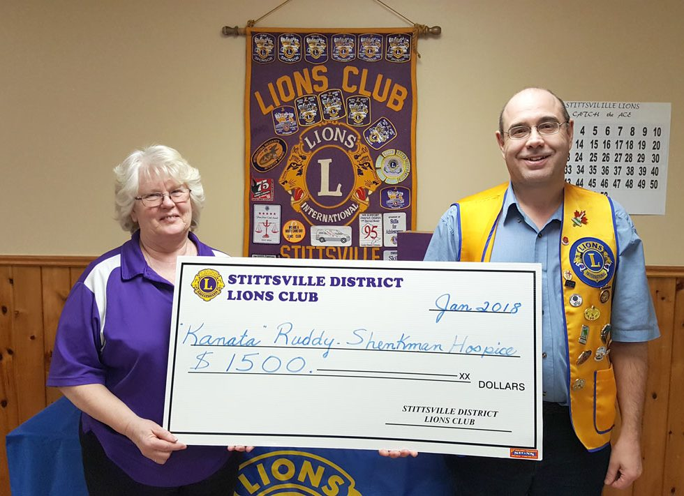 Beth Lewis and Robert Gregory with a donation cheque for $1,500 for the Ruddy-Shenkman Hospice in Kanata. The money was raised through the Lions' Catch the Ace fundraiser last fall.