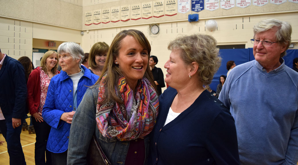 Former teacher Brandi Macgregor (left) embraces former teacher and Vice Principal Wendy Jewel. Photo by Devyn Barrie.