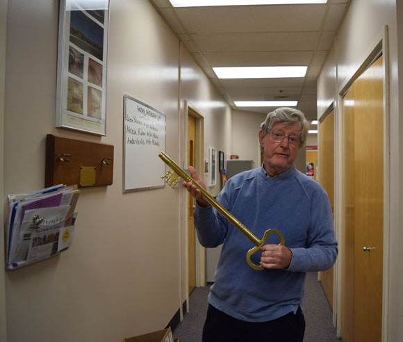 ALC founding principal Mike Mackay holds the school's ceremonial key. Photo by Devyn Barrie.