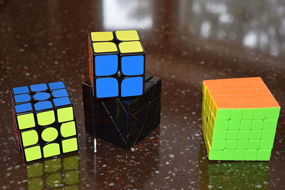 Some of McMahon's cube collection. It includes a 3x3, 2x2, ghost and 5x5.