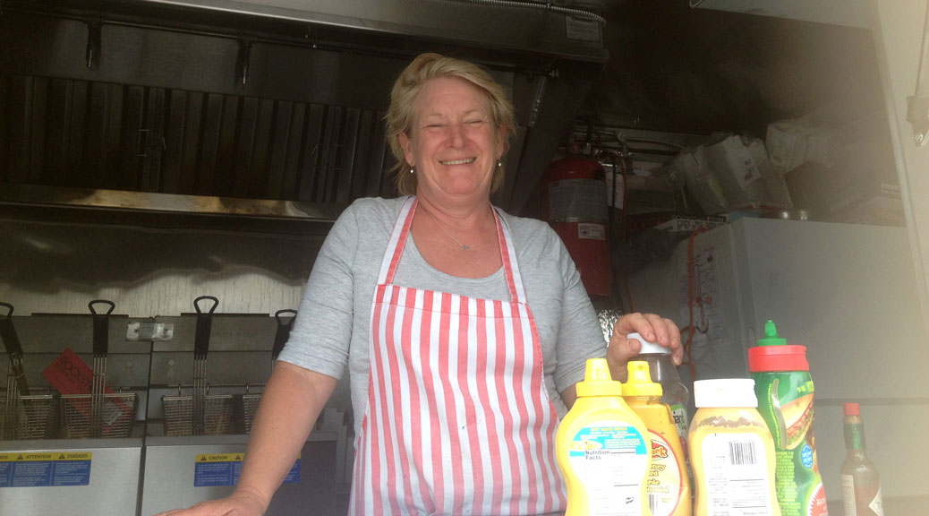 Owner Anne Wilby inside the Mellow Yellow food truck. Photo by Devyn Barrie.