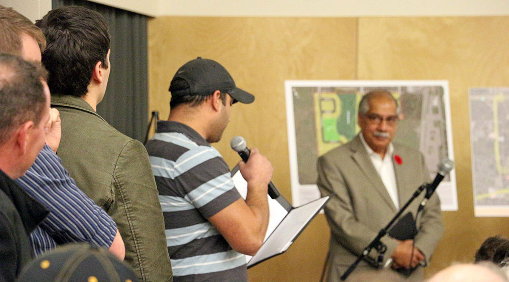 Omar Sultan from the Jackson Trails Community Association, asks a question at the public meeting while councillor Shad Quadri listens in the background. Photo by Shannon Lough.