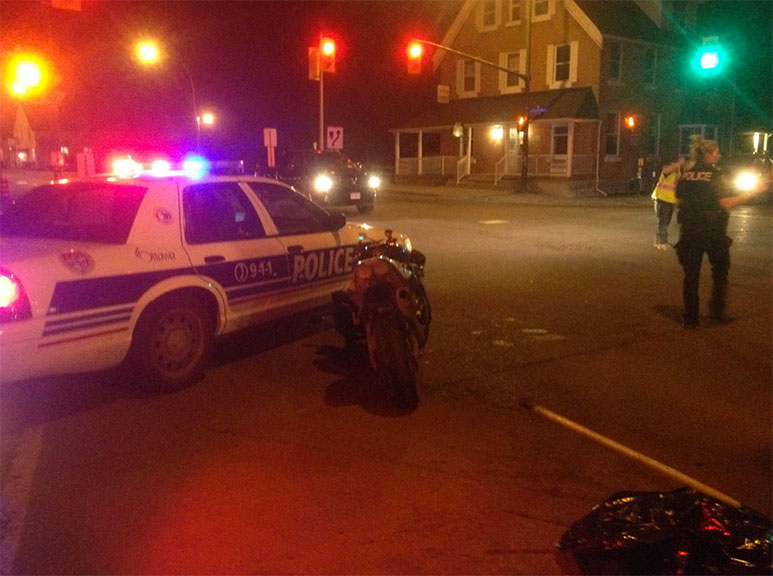 A motorcycle was involved in a collision at Abbott and Stittsville Main on Friday night. Photo by Devyn Barrie.