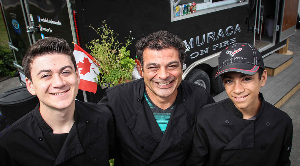 Frank Muraca and his two boys, Giovanni (left) and Dante (right) at the Muraca On Fire food truck in the Rona parking lot on Hazeldean Road. Barry Gray/StittsvilleCentral.