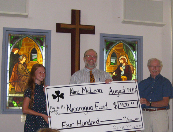 Alice McLean presented her donation to Rev. Grant Dillenbeck and church treasurer, Don Carson during worship on Sunday August 14.
