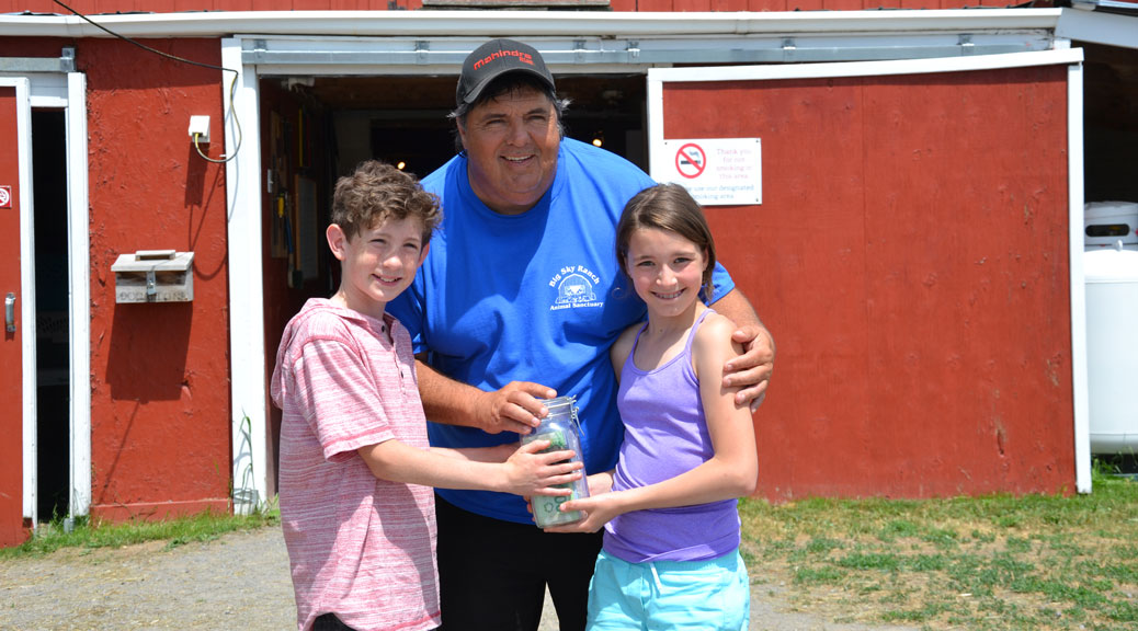 Norah and Jack present their donation to Andy Parent from Big Sky Ranch.