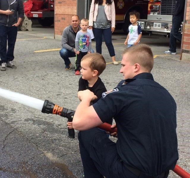 Braeden Mason with Firefighter Josh.