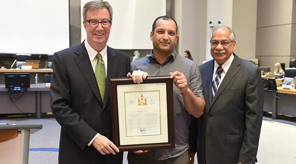 Omar Sultan receives the Mayor's City Builder Award from Mayor Jim Watson and Councillor Shad Qadri