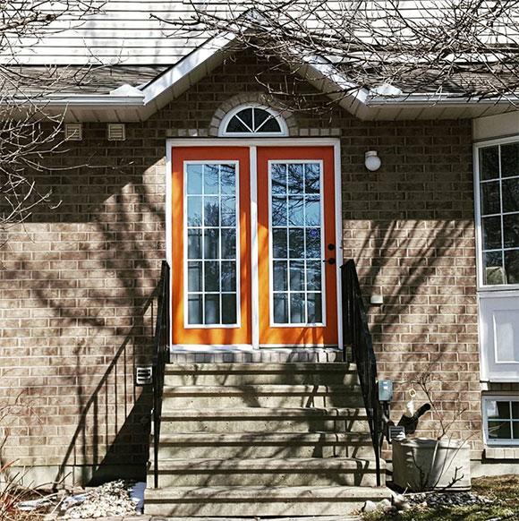 Orange doors on a townhome along Stittsville Main Street.  Photo by Glen Gower