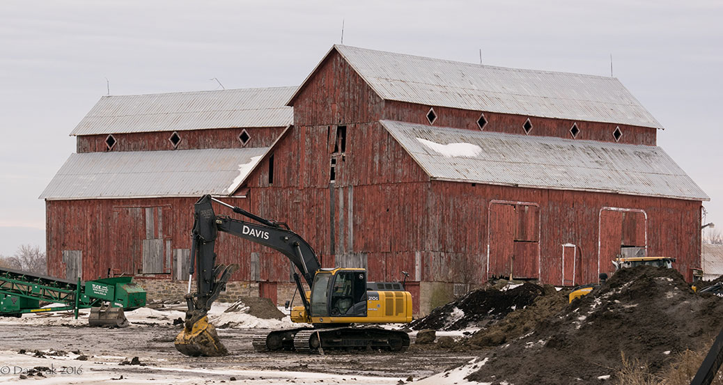 Construction equipment in front of the Bradley-Craig barn. Photo by Dan Pak.