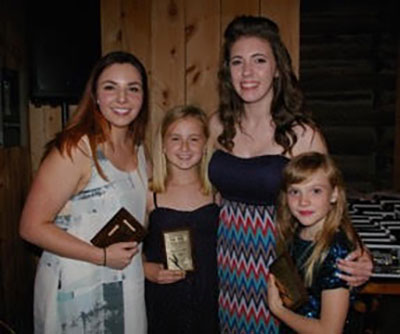 "Pointe fo Grace's ""Spirit"" award winners (left to right) include: Meaghan Fleck, Julia Saunders, Kayla Mills and Evie Inman. The award was presented in loving memory of Pierre Barnett to dancers who show outstanding studio spirit."