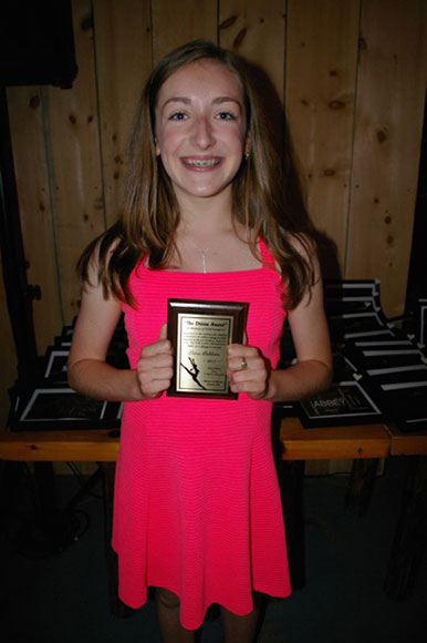 "Erinn Bekkers received Pointe of Grace's ""Drive"" award, which is presented annually to a dancer who displays confidence and endless energy in their pursuit of the art of dance."