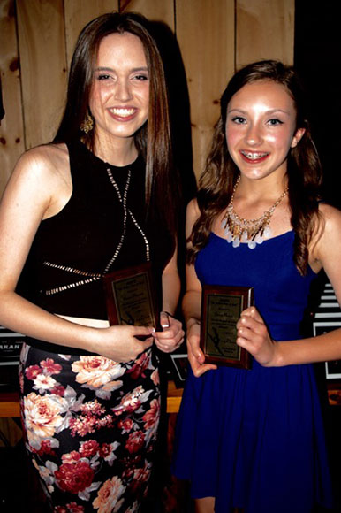 "Renee Theoret and Grace Nolan received Pointe of Grace's ""Agape"" award, which is presented to dancers who show respect and love to their mothers during the dance season."