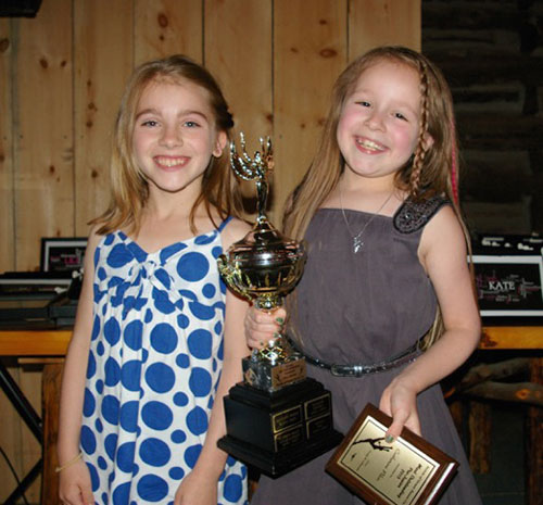 "Last year's winner Hope Bekkers (left) presented this year's ""Most Outstanding Pre-Junior"" trophy to Catherine Pilon."