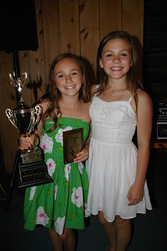 "Vanessa Medaglia (left) accepted the ""Most Outstanding Junior"" trophy from last year's winner, Lili Lapointe."