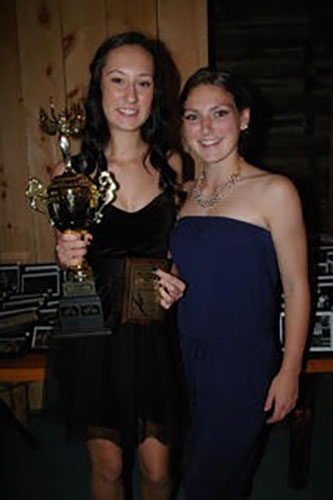 "Kate Pristanski (left) holds her ""Most Outstanding Intermediate"" award, which was presented to her by last year's winner, Lily Fisher."