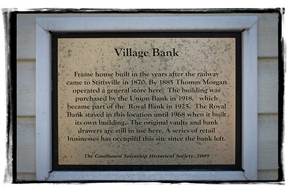Historical plaque on the front of the Pretty Pots building on Stittsville Main Street.