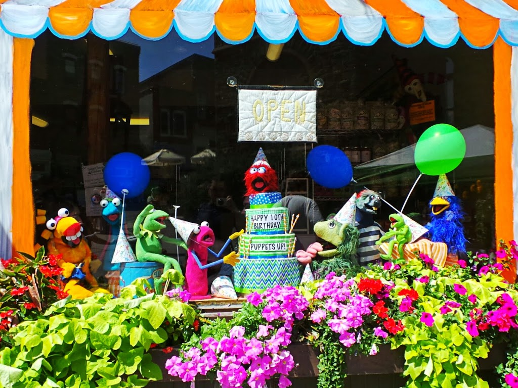 Puppets prepare to devour a birthday cake. Shop window at Bob's Bakery in Almonte. Photo by Glen Gower.