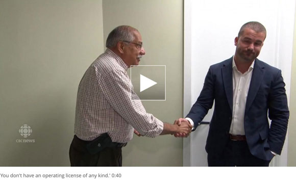 "In this screen capture from a CBC story, Councillor Shad Qadri shakes the hand of Magna Terra owner Franco Vigile at an open house at the facility in August. ""You don't have an operating license of any kind,"" Qadri told Vigile."