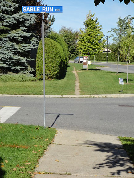 In the summer, residents just walk across the grass.