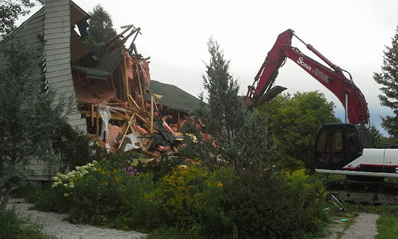 Demolition of a home at 180 Huntmar, August 2015.