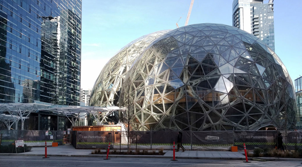 "Amazon's headquarters in Seattle include three ""biospheres"" filled with plants and endangered species. Photo by brewbooks, used under a Creative Commons license."