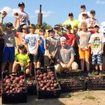 Silver Seven team helps harvest for the Food Bank