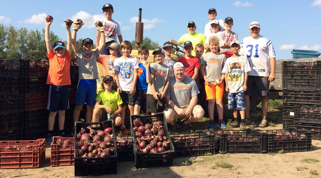 The Silver Seven Major Atom AA participated in the Community Harvest Program at Black Farm, for the Ottawa Food Bank.