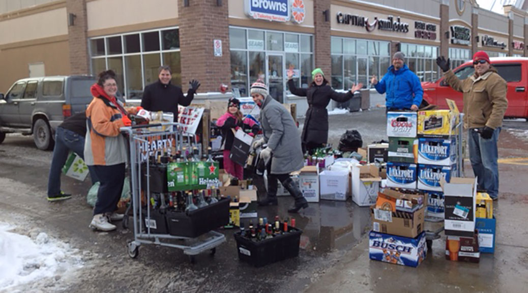 Volunteers from the Stittsville Minor Hockey Association collect bottles, raising money for the Kelly family and their son's battle with cancer.