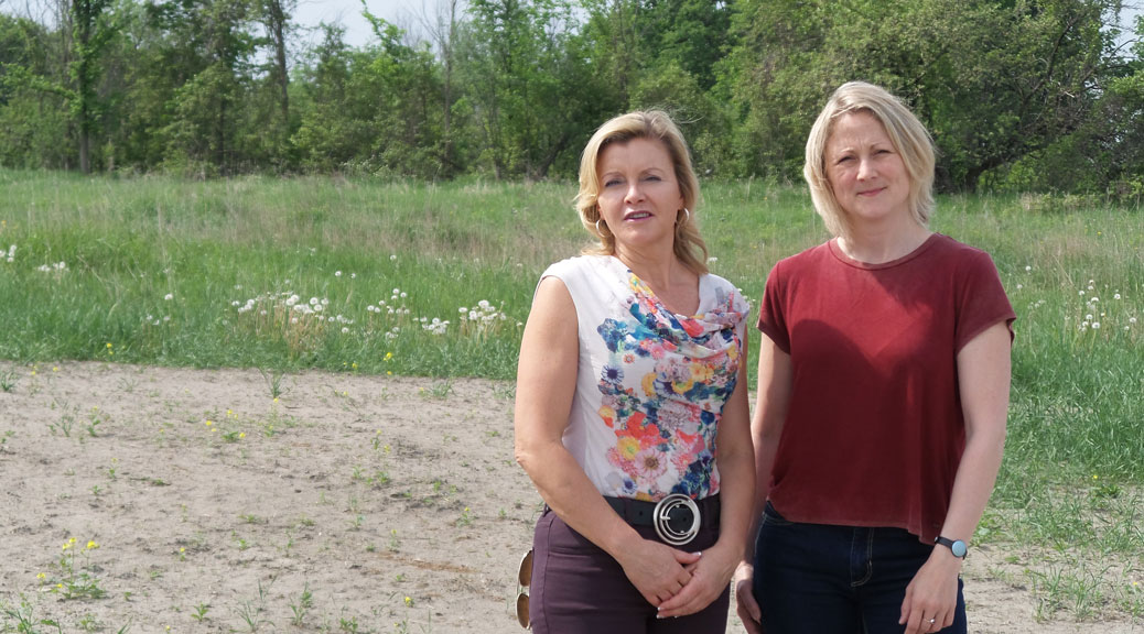 Jennifer Smith (left) and Jenny Guth have been two of the most active parents involved in the push for a public high school. They're standing on one of the possible sites for the new school, at the south west corner of Robert Grant and Cope.