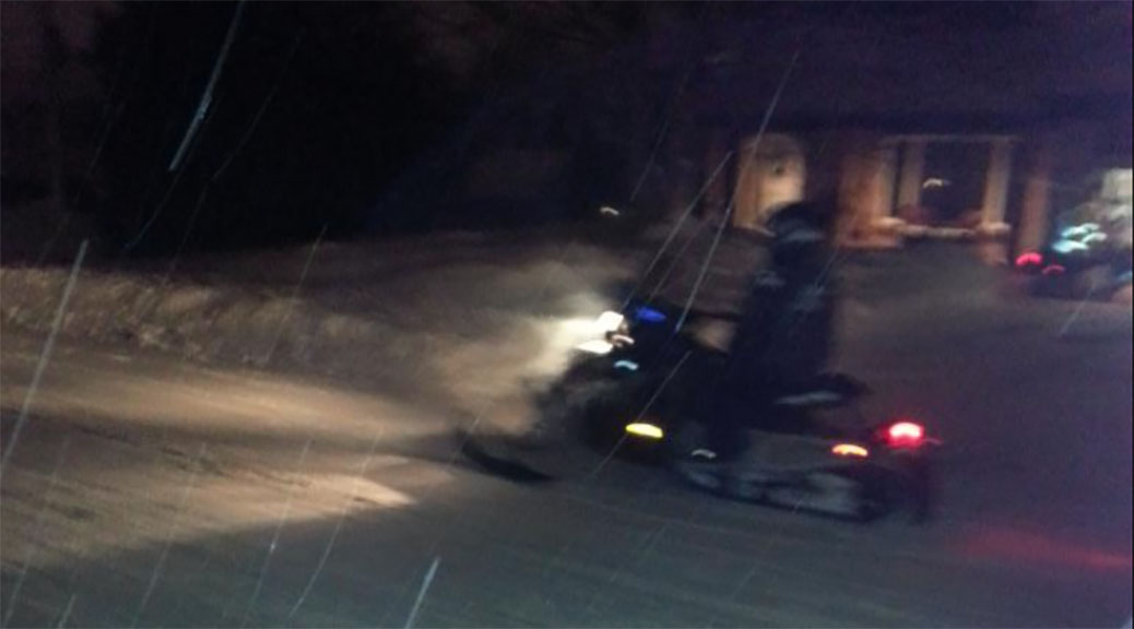 Snowmobile on Jonathan Pack Street in Stittsville.