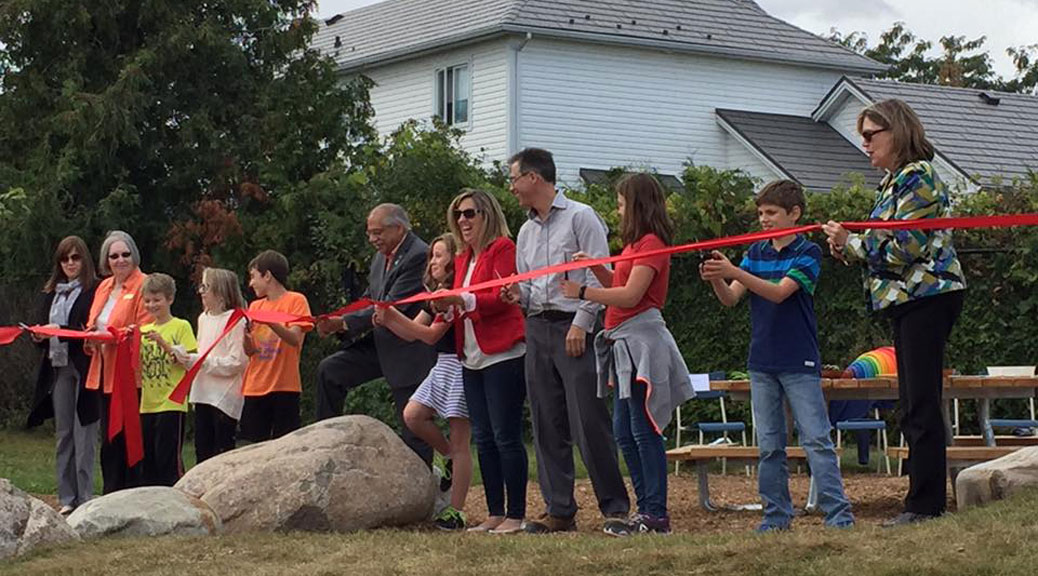 Students, staff, volunteers and elected officials took part in a ribbon-cutting ceremony -- complete with kid-sized scissors -- at Stittsville Public School on Friday, September 29. It marked the official opening of a new outdoor classroom. Photo by Lorrie Hayes.