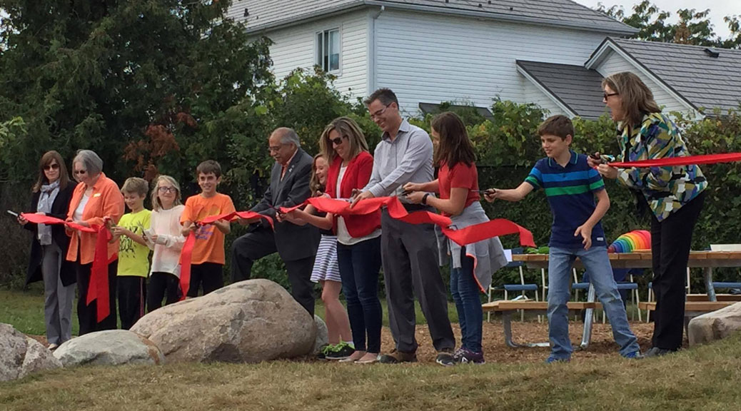 Students, staff, volunteers and elected officials took part in a ribbon-cutting ceremony -- complete with kid-sized scissors -- at Stittsville Public School on Friday, September 29. It marked the official opening of a new outdoor classrom. Photo by Lorrie Hayes.