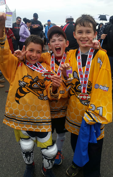 2017 SKM Software Stingers players celebrate after receiving their medals.