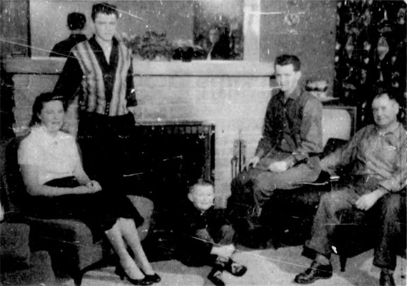 "The article included a photo of the Ritchie family: ""...the family of Ray Ritchie, shown in the living room of their comfortable new home in one of Stittsville's new housing developments. Homes there sell for as low as $12,000; taxes are low and town is only 16 miles from Ottawa. Left to right are Mrs. Ritchie, Larry, 15; Kevin, 6; Brent, 18, and Mr. Ritchie. Photos by Newton."""